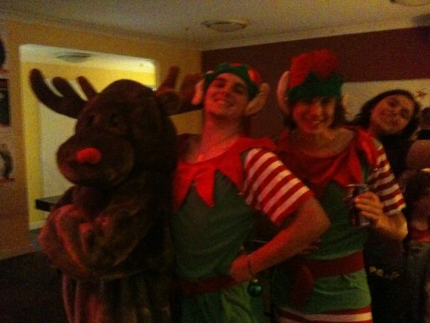 SMILING: Christmas party with Rudolph and some friends. I'm the elf on the right.